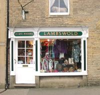 View of the front of Lambswold Clothing shop in The Square Stow on the Wold